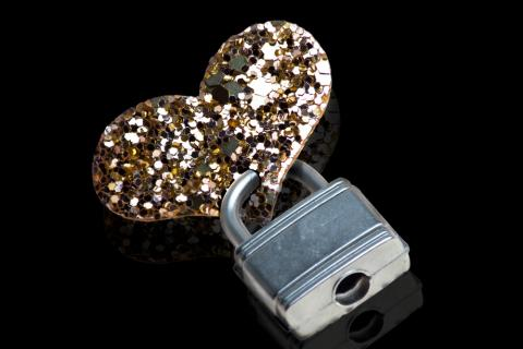 Heart lock and key photo, Paul J. West/Shutterstock.com