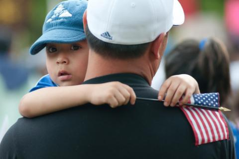 Nelson Navidad holds his son at a 2009 immigration rally. RyanRoderickBeiler.c /