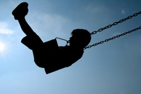 Child swinging, Ana de Sousa / Shutterstock.com