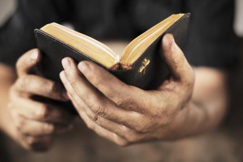 Man holding Bible photo,  Stocksnapper / Shutterstock.com