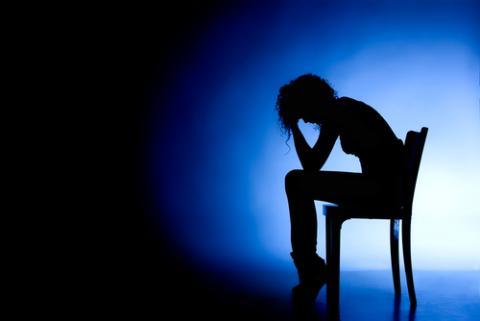 Illustration of woman in despair, Vedran Vidovic / Shutterstock.com