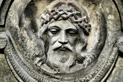 Face of Jesus from an old cemetery statue. Photo by Brasiliao/Shutterstock.com.