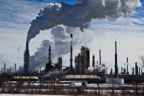 Oil refinery emissions, David Sprott / Shutterstock.com