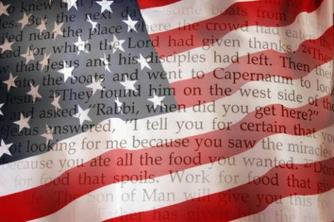 Bible on an American flag. Image courtesy Sergey Kamshylin/shutterstock.com