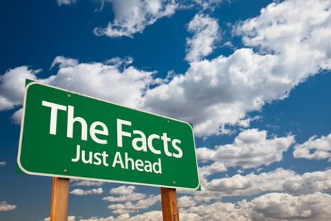Just the Facts signage, Andy Dean Photography / Shutterstock.com