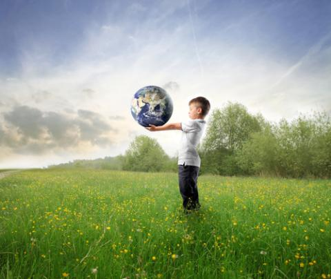 Child holding the earth, olly, Shutterstock.com