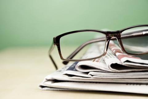 Stack of newspapers photo, kret87 / Shutterstock.com
