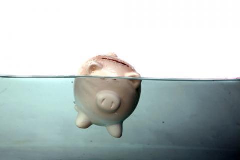 Debt crisis illustration, mikeledray / Shutterstock.com