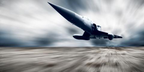Military plane, Andrey Yurlov/ Shutterstock.com