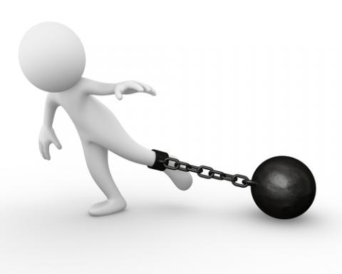 Ball and chain holding person back, Air0ne / Shutterstock.com