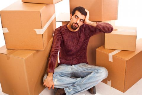 Man among moving boxes, William Perugini / Shutterstock.com