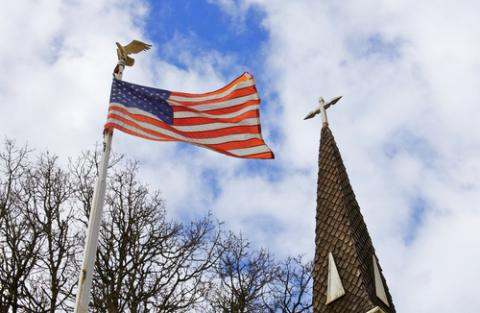 American flag and church steeple, Bobkeenan Photography / Shutterstock.com