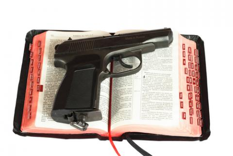 Religion and gun photo,  sagasan / Shutterstock.com