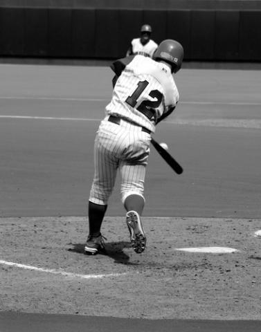 Black and white image of baseball player, Richard Paul Kane / Shutterstock.com