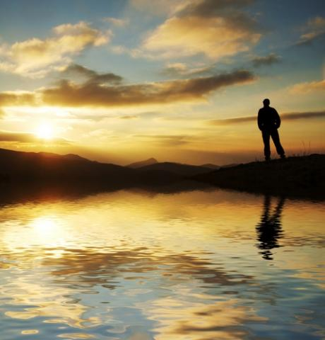 Silhouette of man in front of sunset, Galyna Andrushko / Shutterstock.com