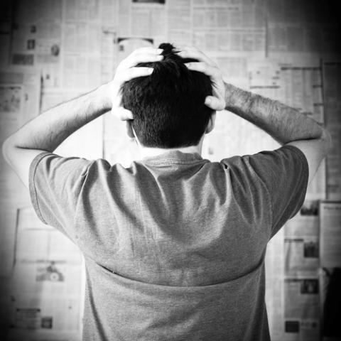 Man overwhelmed by bad news, Joyce Vincent / Shutterstock.com
