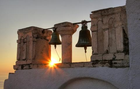 Photo: Church bells at sunset, © Magdalena Bujak / Shutterstock.com