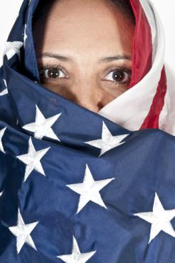 Woman wrapped in an American flag. Image courtesy Rob Byron/shutterstock.com.