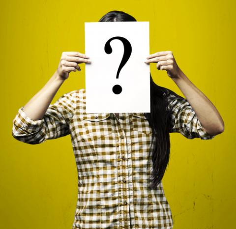 Photo of a woman with question mark sign, Aaron Amat / Shutterstock.com