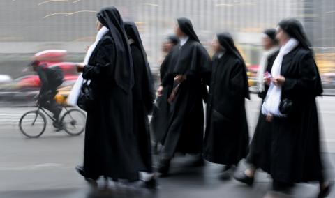 Group of a nuns walking, SVLuma/Shutterstock.com