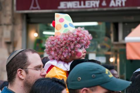 Purim carnival in Jerusalem. Unidentified people watch the show. (Ekaterina Lin