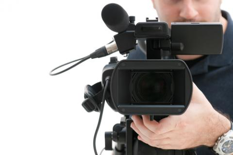 Video camera operator, © Rido/ Shutterstock.com