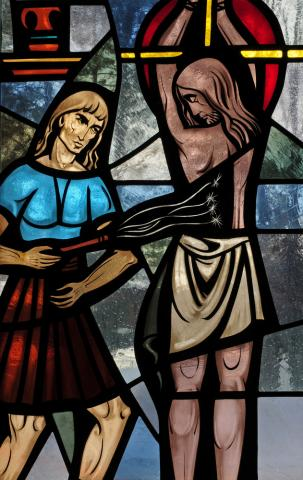 Stained glass window of Jesus scourging, Nancy Bauer / Shutterstock.com