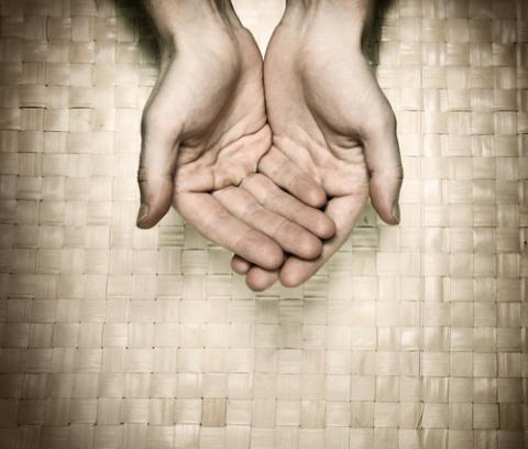 Offering hands, Antonov Roman/ Shutterstock.com