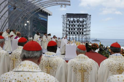 Cardinals stand nearby as Pope Francis celebrates the closing Mass of World Yout