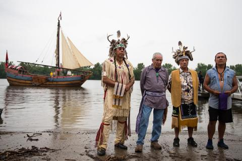 Native leaders stand together at the Hudson river's edge on Sunday to deliver th