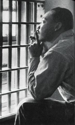 Photograph of Rev. Dr. Martin Luther King, Jr., in the Birmingham City Jail, April 1963.