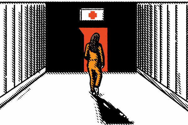 A woman wearing an orange jumpsuit walks down a hallway toward a door with a first-aid symbol over it.