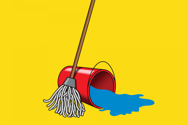 A mop stands next to a red bucket of water that is tipped over and spilling water.