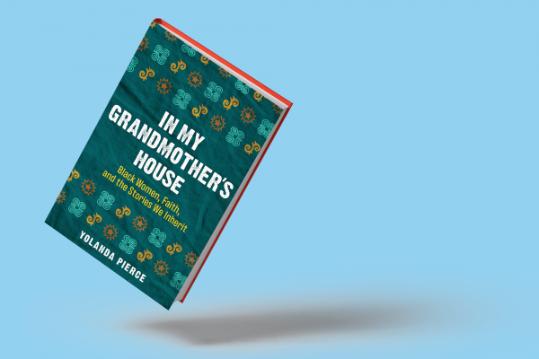 The cover of In My Grandmother's House is blue with small yellow and orange designs.