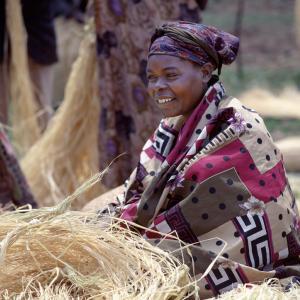 Ugandan woman photo, Nigel Pavitt / Getty Images