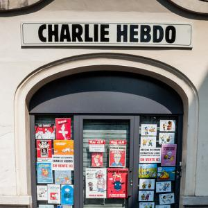 A Charlie Hebdo building with cartoons on the doors. Photo courtesy Brigitte Dja