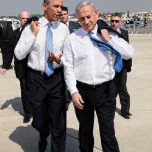 President Barack Obama walks across the tarmac with Israeli Prime Minister Benja