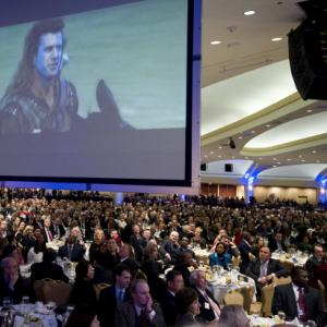 "Scene from ""Braveheart"" is projected at the 2011 National Prayer Breakfast."