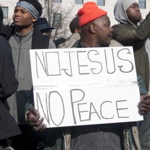 A protester holds a sign at the Justice for All march on Saturday in Washington.