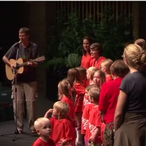 Bryan Moyer leading children in song