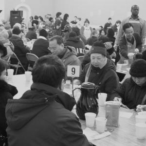 People gather in the Father's Heart Ministries soup kitchen. Image courtesy Fath