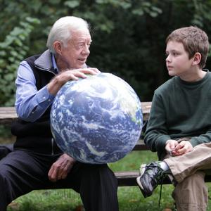 Jimmy Carter with his grandson in 2009. Image via http://bit.ly/zQs4Q4