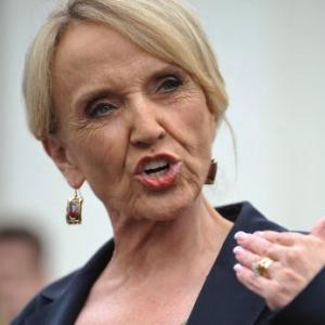 Arizona Gov. Jan Brewer speaks to reporters in 2010. Photo via Getty Images.