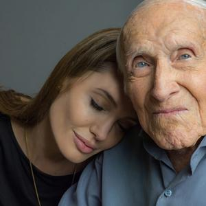 Angelina Jolie with Louis Zamperini. Photo courtesy of Universal / RNS.