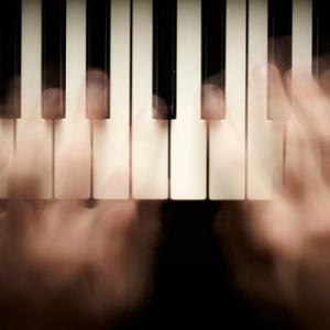 Photo: Hands playing piano, © silver-john / Shutterstock.com