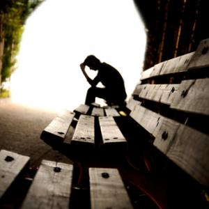 Suffering, with light at the end of the tunnel, hikrcn/ Shutterstock.com