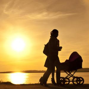 Women with baby carriage, vonzolomon / Shutterstock.com