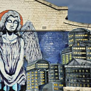 An angel surveys a city. Image courtesy Neale Cousland/shutterstock.com