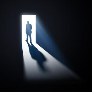 man walking through open doors, Mopic / Shutterstock.com