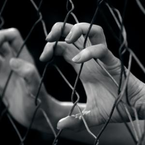 Sex trafficking illustration, ChameleonsEye / Shutterstock.com